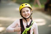 Helmet - Safety Equipment For Little Girl Playing. Helmet And Safety Equipment. Rope Park - Climbing poster