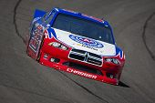 FONTANA, CA - MARCH 23:  A.J. Almendinger (22) brings his race car through turn 4 during a practice