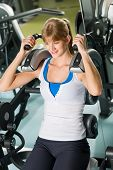 Fitness center young woman exercise abdominal muscles on gym machine