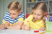 Cute Schoolchildren Are Came Back To School And Learning At The Table In Classroom poster
