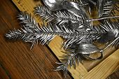 Silver Painted Fir Branches Closeup On Wooden Background. Silver Conifer Tree Branches. Contrast Con poster