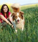 image of dog park  - Young woman with dog outside - JPG