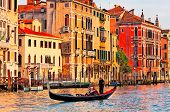 stock photo of gondolier  - Gondolier navigates the venetian canal - JPG
