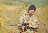 Man Aiming Target Nature Background. Hunter Hold Rifle. Aiming Skills. Hunting Permit. Bearded Hunte poster
