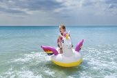Child Girl Floatting On White, Trendy Beach Unicorn On The Background Of Turquoise Sea Water. Girl S poster