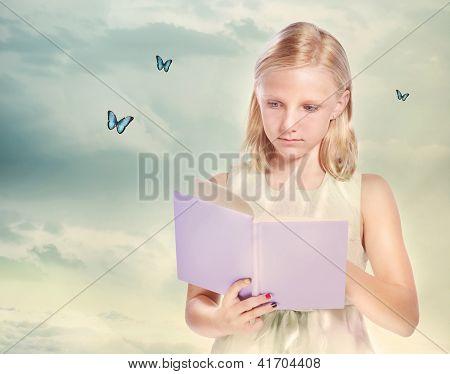 Little Blonde Girl Reading A Book