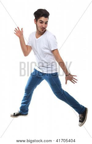 Portrait Of Man Dancing On White Background