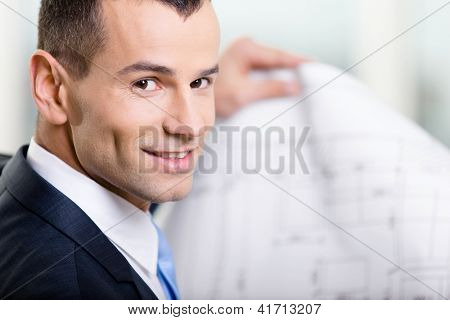 Close up of business man with draft. Concept of successful construction