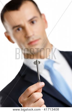 Manager shows key, isolated on white. Real estate concept and successful bargain
