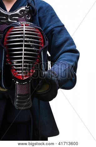 Close up of kendo helmet in hands of kendoka, isolated on white. Japanese martial art of sword fighting