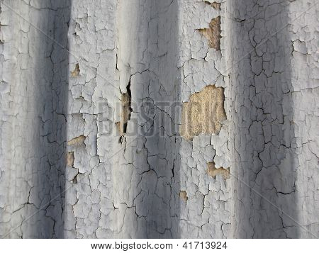 Crack Gray Paint On Grooved Wall