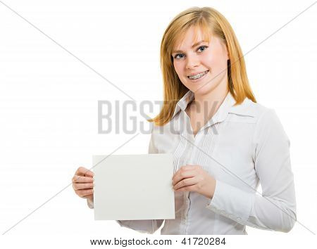 Young Smiling Woman With Brackets And White Billboard