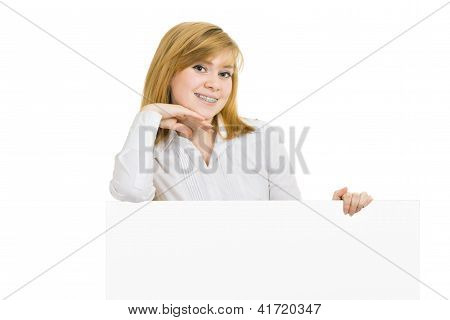 Young Smiling Girl With Brackets And Billboard