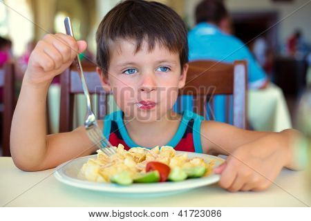 Cute little boy enjoying food