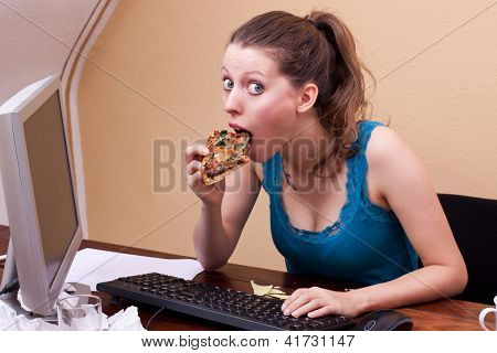 Pretty Student Eats A Piece Of Pizza