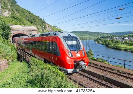 Intercity Train Leaving A Tunnel Near The River Moselle In Germany