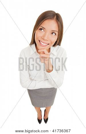 Thinking beautiful smiling business woman looking up isolated on white background in high angle view. Mixed race ethnic Asian Chinese / Caucasian businesswoman.