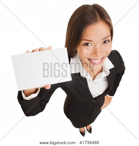 Business woman showing blank card sign. Businesswoman holding empty card with copy space smiling happy standing isolated on white background in full body length. Mixed race Asian Chinese / Caucasian.