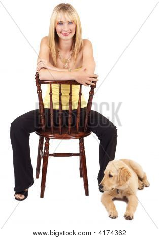 Portrait Of Beautiful Blonde Woman With Dog