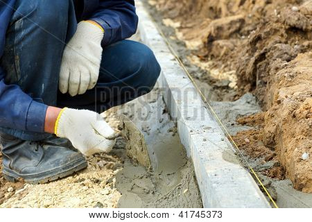 Worker placed curbs, close-up photos.