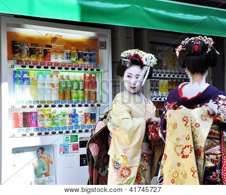 Kyoto, Japan - Oct 21 2012: Japanese Ladies In Traditional Dress  On A Street Leading To Kiyomizu Te