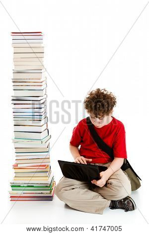 Boy sitting close to pile of books on white background