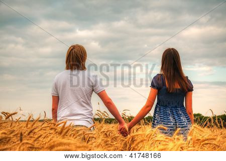Couple Staying At A Wheat Field