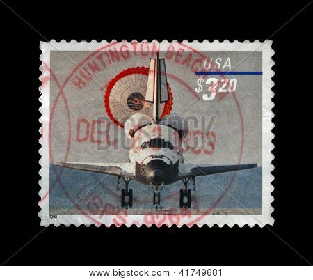 Usa - Circa 1998: Stamp Printed In Usa, Shows Space Shuttle With Parachute Landing, Circa 1998.