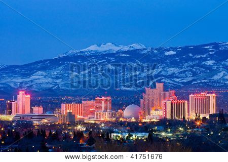 RENO - FEBRUARY 2: Reno skyline on February 3, 2013. It's known as The Biggest Little City in the World, famous for it's casinos and is the birthplace of the gaming corporation Harrah's Entertainment.
