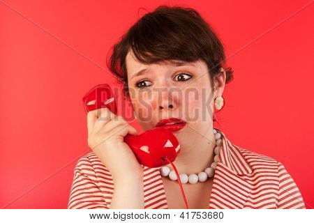 Woman crying while having a sad phone call