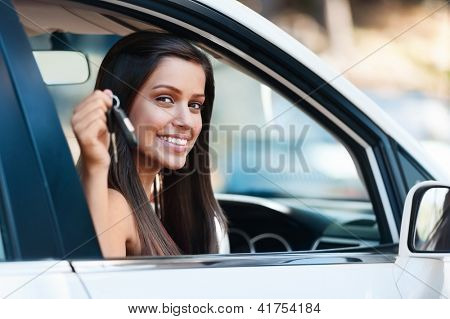 happy learner driver young girl smiling portrait with car keys
