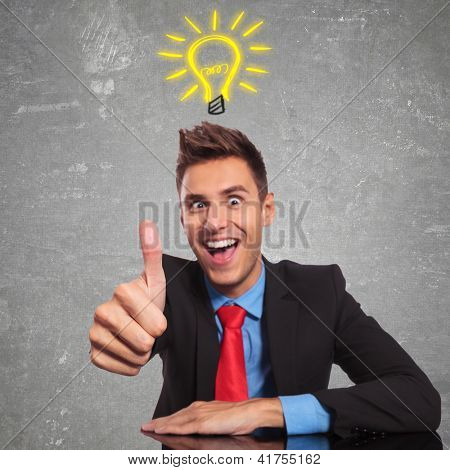 business man having a great idea and making the ok thumbs up gesture - focus on his finger