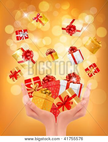 Holiday background with hands holding gift boxes. Concept of giving presents. Raster version of vector.