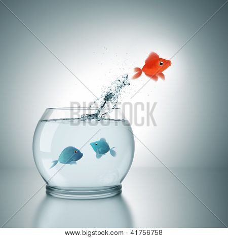 A fishbowl with a red fish jumping out of the water