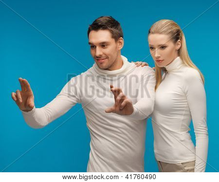 picture of  man and woman working with something imaginary