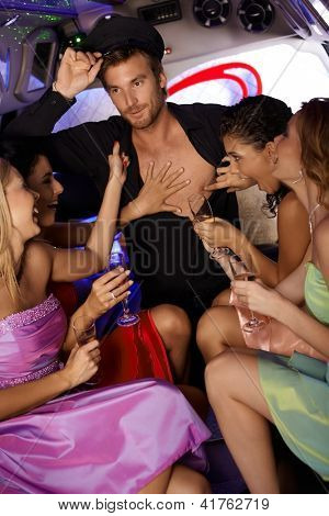 Hot hen party in limousine with beautiful girls and chauffeur boy.