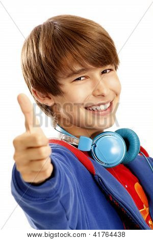 Young Boy Showing A Thumbs Up