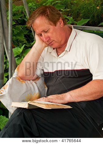 Middle-aged Man Reading A Book