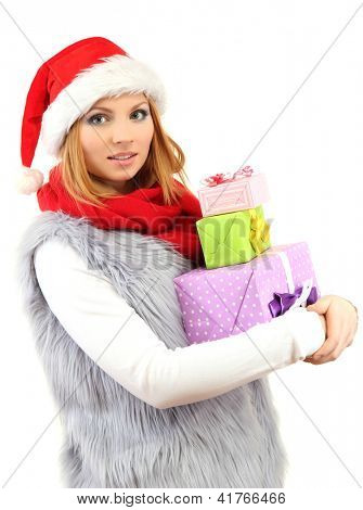 Attractive young woman holding Christmas gifts, isolated on white
