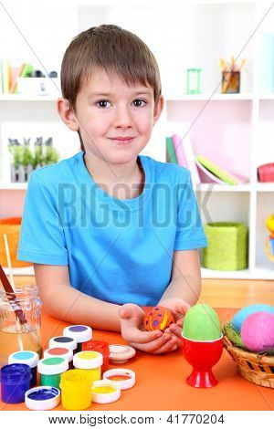 Child's hands holding painted easter egg