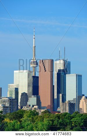Toronto skyline over park with urban buildings and blue sky