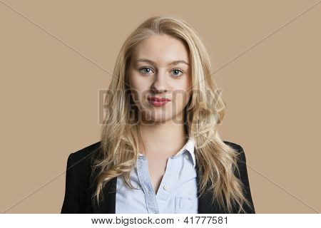 Portrait of a beautiful blond business woman over colored background
