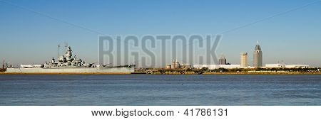 Panoramic of Mobile, Alabama, skyline with U.S.S. Alabama in foreground on Mobile Bay