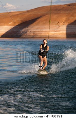 Blonde Girl Wakboarding At Sunset