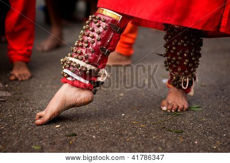 Close up of a devotee's leg at Thaipusam event celebrating Lord Murugan, Batu Caves, Kuala Lumpur, Malaysia