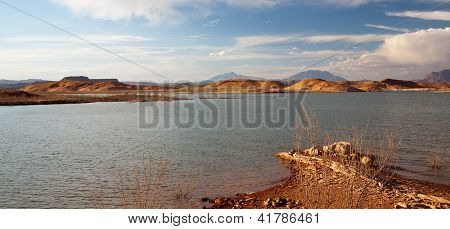 Desert Lake And Hills Landscape