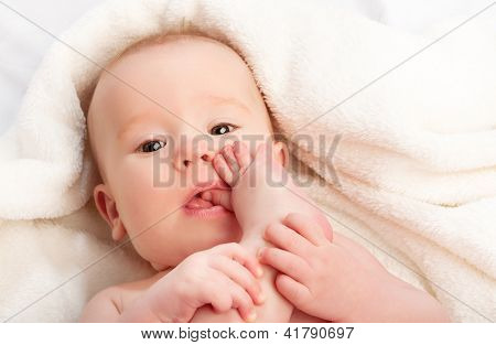 Small Baby Sucking Her Finger On Leg