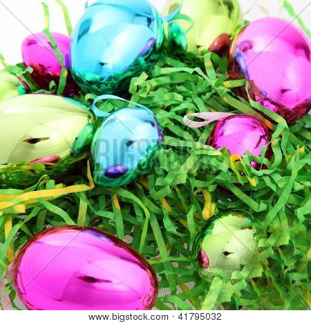 Bright Colourful Easter Eggs On Straw