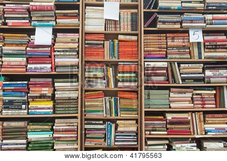 SARAJEVO, BOSNIA - AUGUST 11: Bookshelves on street market on August 11, 2012 in Sarajevo, Bosnia. Outdoor book markets are common occurrence in the cultural city of Sarajevo.