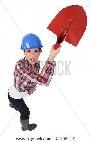 angry craftswoman holding a shovel